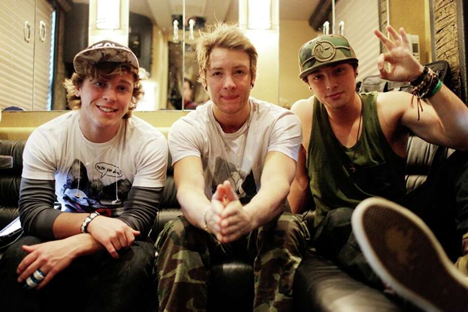 """Pop band, Emblem3 is photographed on their tour bus prior to performing for fans, during a stop on their \""""Goin Back to Cali\"""" tour, Sunday, April 21, 2013 at Stereo Live, in Houston, Texas. Photo: © TODD SPOTH, 2013 / © TODD SPOTH, 2013"""