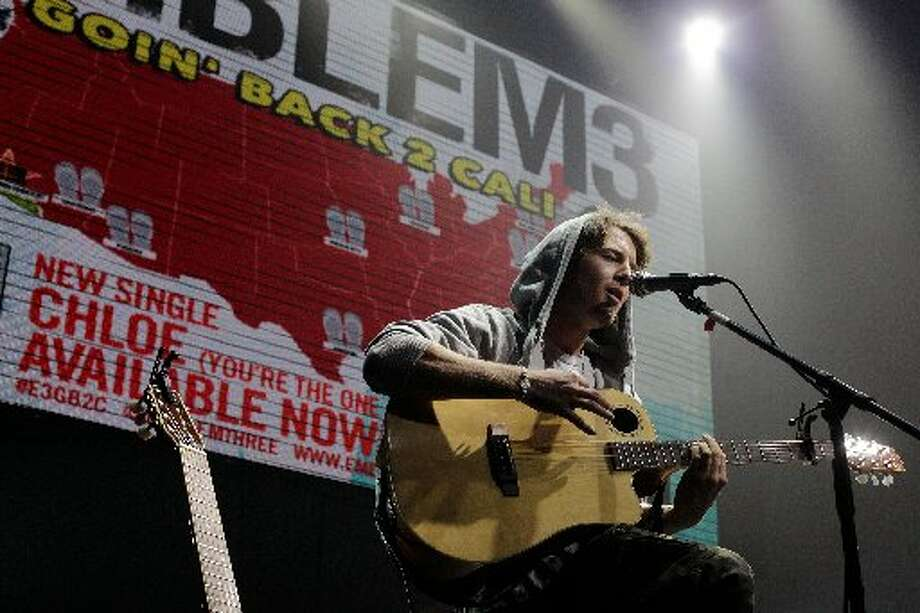 Emblem3\'s Drew Chadwick onstage in Houston.