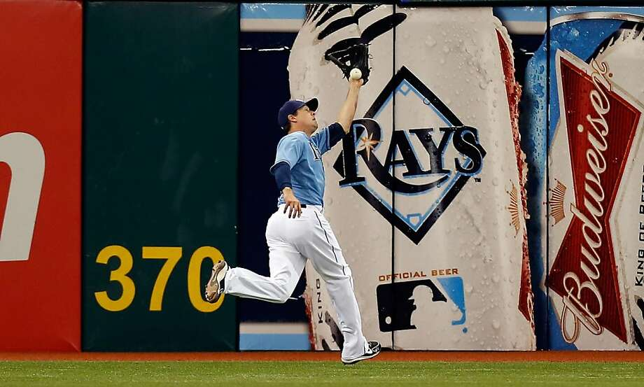 ST. PETERSBURG - APRIL 21:  Outfielder Kelly Johnson #2 of the Tampa Bay Rays cannot make the catch on this fly ball against the Oakland Athletics during the game at Tropicana Field on April 21, 2013 in St. Petersburg, Florida.  (Photo by J. Meric/Getty Images) Photo: J. Meric, Getty Images