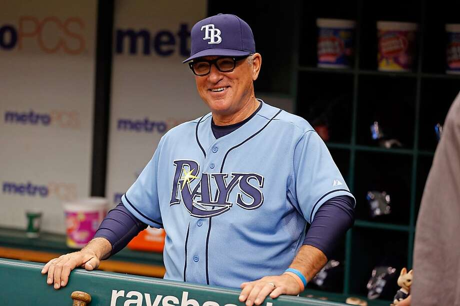ST. PETERSBURG - APRIL 21:  Manager Joe Maddon #70 of the Tampa Bay Rays smiles just before the start of the game against the Oakland Athletics at Tropicana Field on April 21, 2013 in St. Petersburg, Florida.  (Photo by J. Meric/Getty Images) Photo: J. Meric, Getty Images