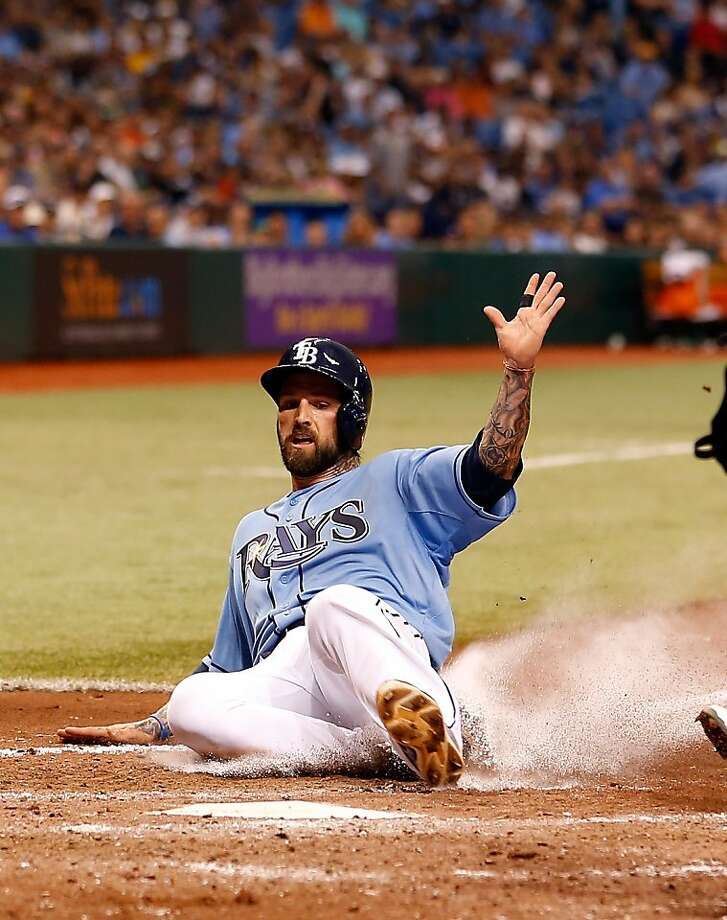 ST. PETERSBURG - APRIL 21:  Infielder Ryan Roberts #19 of the Tampa Bay Rays scores on a wild pitch against the Oakland Athletics during the game at Tropicana Field on April 21, 2013 in St. Petersburg, Florida.  (Photo by J. Meric/Getty Images) Photo: J. Meric, Getty Images