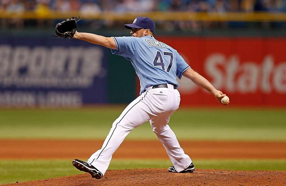 ST. PETERSBURG - APRIL 21:  Pitcher Brandon Gomes #47 of the Tampa Bay Rays pitches against the Oakland Athletics during the game at Tropicana Field on April 21, 2013 in St. Petersburg, Florida.  (Photo by J. Meric/Getty Images) Photo: J. Meric, Getty Images