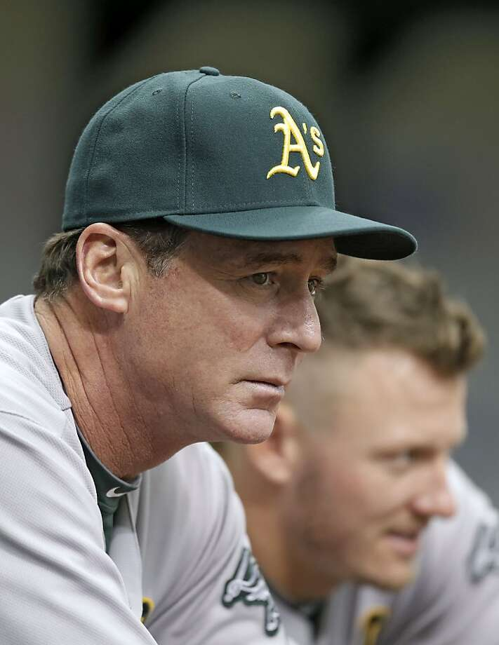 Oakland Athletics manager Bob Melvin watches with Josh Donaldson during the first inning of a baseball game against the Tampa Bay Rays Sunday, April 21, 2013, in St. Petersburg, Fla. (AP Photo/Chris O'Meara) Photo: Chris O'Meara, Associated Press