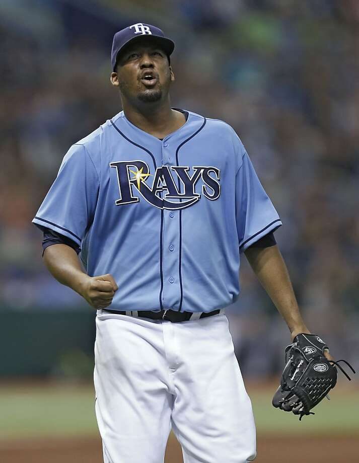 Tampa Bay Rays starting pitcher Roberto Hernandez reacts after throwing out of a fifth-inning, bases-loaded jam against the Oakland Athletics during a baseball game Sunday, April 21, 2013, in St. Petersburg, Fla. (AP Photo/Chris O'Meara) Photo: Chris O'Meara, Associated Press