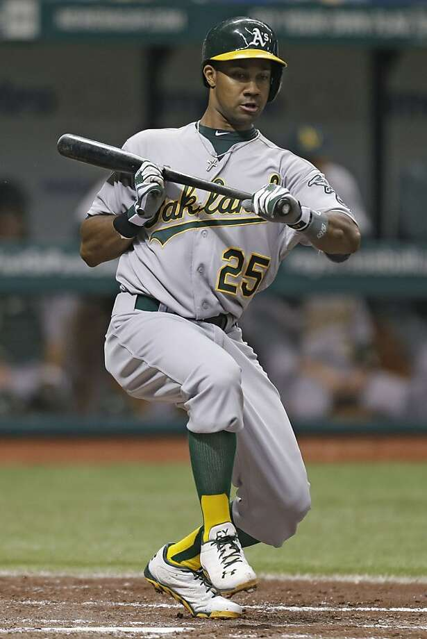 Oakland Athletics' Chris Young attempts to  bunt of a pitch by Tampa Bay Rays starting pitcher Roberto Hernandez during the fourth inning of a baseball game Sunday, April 21, 2013, in St. Petersburg, Fla. (AP Photo/Chris O'Meara) Photo: Chris O'Meara, Associated Press