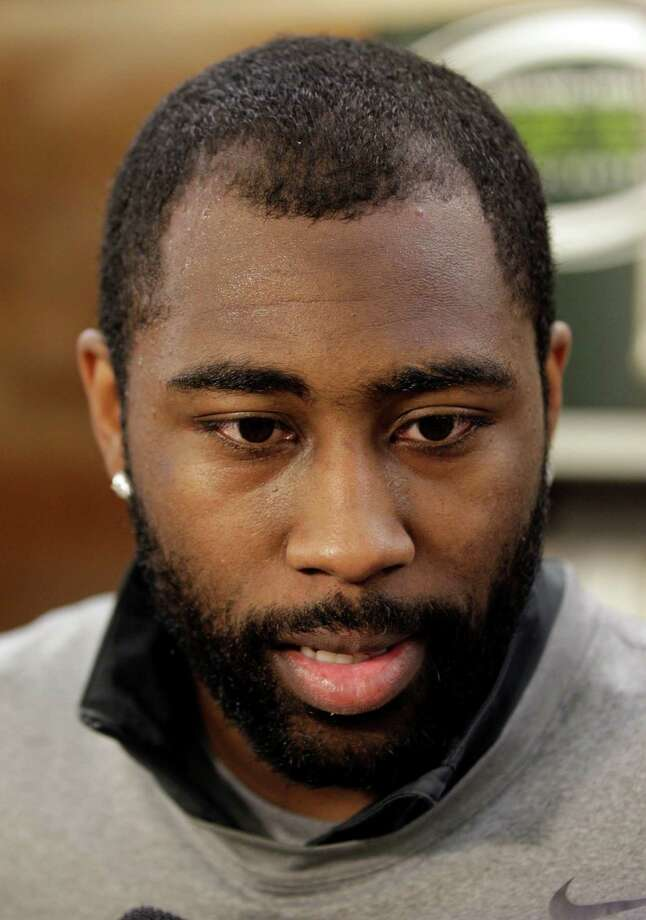 FILE - In this Thursday, May 10, 2012 file photo, New York Jets cornerback Darrelle Revis talks to the media near his locker at the team's football training facility,  in Florham Park, N.J. Revis and the New York Jets appear on the verge of parting ways. A person familiar with the situation told The Associated Press on Sunday, April 21, 2013, that the Jets granted Revis permission to take a physical and negotiate a contract with the Tampa Bay Buccaneers, signaling a trade is imminent. (AP Photo/Julio Cortez, File) Photo: Julio Cortez