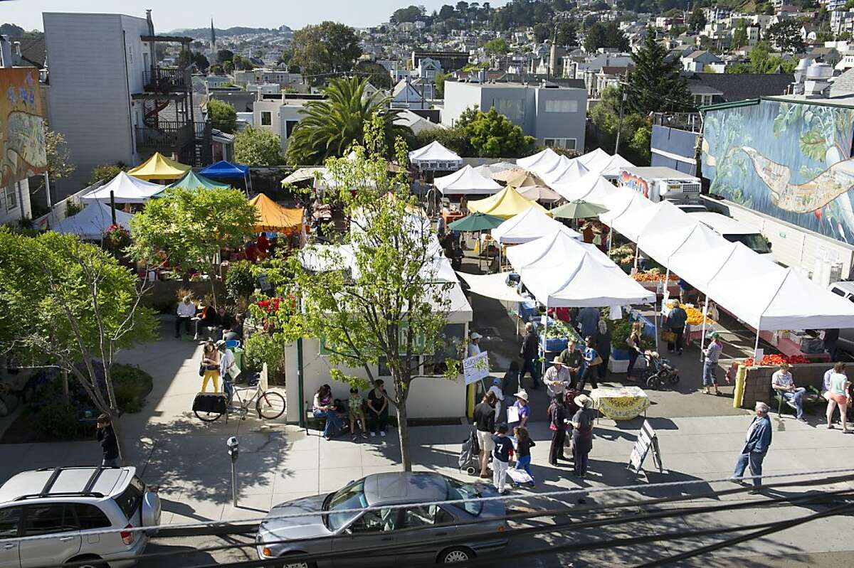 Tents are set up in the parking lot on 24th street at the Noe Valley Farmers Market in San Francisco, Calif. on April 20, 2013.