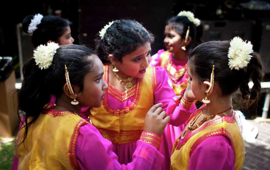 Natyra Upasana Academy of Indian Dance performer Anjuli Perubhatla, 8, center, checks Urvi Bhatia's, 9, eye make up before performing during the 43rd Annual Houston International Festival, Sunday, April 21, 2013, in Houston. The festival ail continue through April 27-28th, 11 a.m. to eight p.m. The festival features seven stages, a Brailian living museum and six multicultural markets. Photo: Nick De La Torre, Chronicle / © 2013 Houston Chronicle