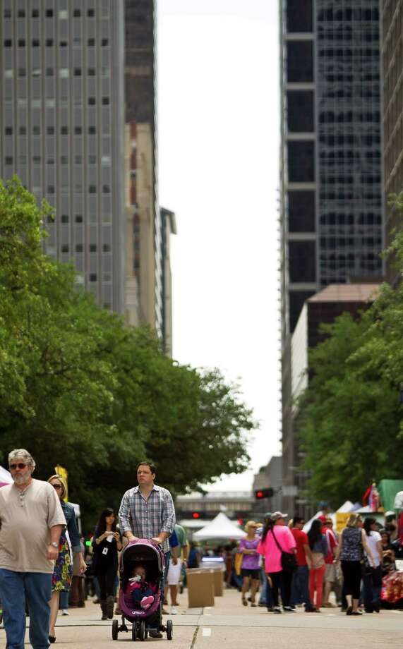 Streets surrounding Houston City Hall are closed for foot traffic during the 43rd Annual Houston International Festival, Sunday, April 21, 2013, in Houston. The festival ail continue through April 27-28th, 11 a.m. to eight p.m. The festival features seven stages, a Brazilian living museum and six multicultural markets. Photo: Nick De La Torre, Chronicle / © 2013 Houston Chronicle