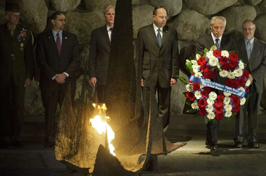 U.S. Secretary of Defense Chuck Hagel (second from right) places a wreath at the Hall of Remembrance in Jerusalem.  Photo: Jim Watson, Associated Press