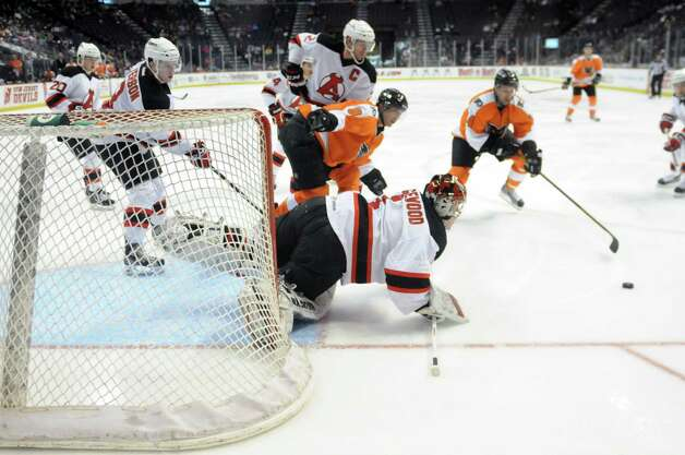 Albany Devils? goalie Scott Wedgewood makes a diving save in the third period against the Adirondack Phantoms, Sunday evening April 21, 2013, at the Times Union Center in Albany, N.Y. (Will Waldron/Times Union) Photo: Will Waldron