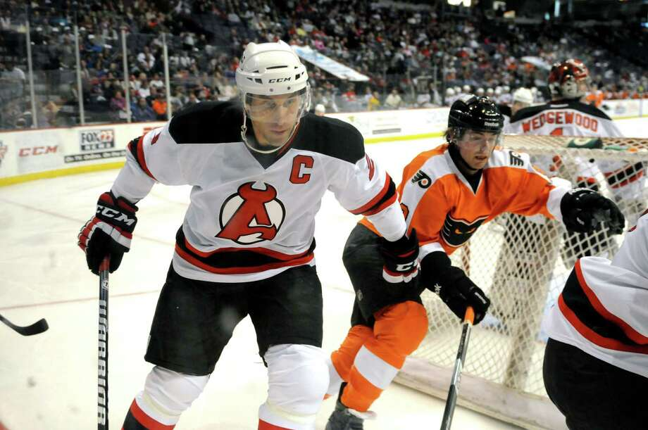 Albany Devils? Jay Leach defends against the Adirondack Phantoms in the third period, Sunday evening April 21, 2013, at the Times Union Center in Albany, N.Y. (Will Waldron/Times Union) Photo: Will Waldron