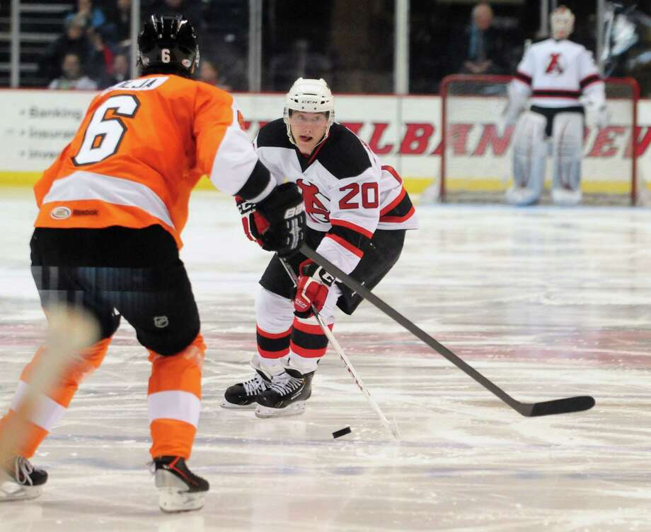 Albany Devils? Reid Bucher, right, advances toward the Adirondack Phantoms goal, as Andreas Lilja, left, defends Sunday evening, April 21, 2013,  during the second period at the Times Union Center in Albany, N.Y. (Will Waldron/Times Union) Photo: Will Waldron
