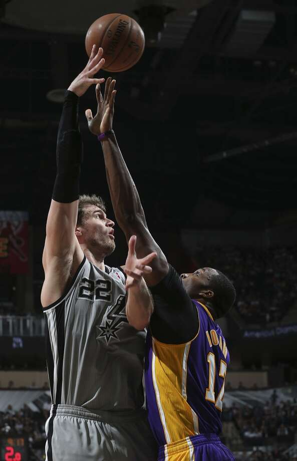 San Antonio Spurs\' Tiago Splitter shoots over Los Angeles Lakers\' Dwight Howard during the first half of game 1 in the first round of the NBA Playoffs at the AT&T Center, Sunday, April 21, 2013.