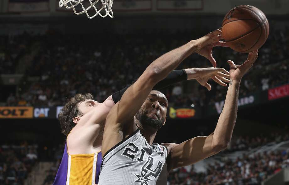 San Antonio Spurs\' Tim Duncan fights for a rebound against Los Angeles Lakers\' Pau Gasol during the first half of game 1 in the first round of the NBA Playoffs at the AT&T Center, Sunday, April 21, 2013.