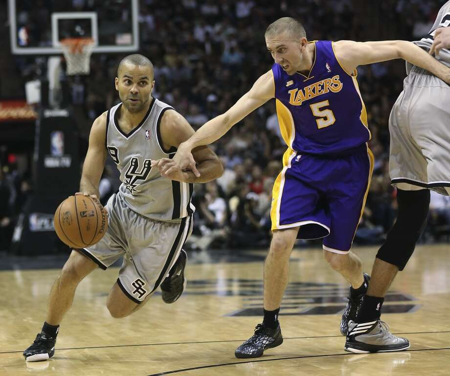 Los Angeles Lakers\' Steve Blake tries to keep up with San Antonio Spurs\' Tony Parker during the second half of game 1 in the first round of the NBA Playoffs at the AT&T Center, Sunday, April 21, 2013. The Spurs won 91-79.
