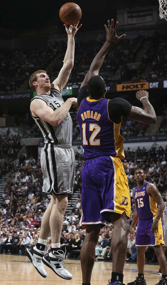 San Antonio Spurs\' Matt Bonner shoots over Los Angeles Lakers\' Dwight Howard during the first half of game 1 in the first round of the NBA Playoffs at the AT&T Center, Sunday, April 21, 2013.