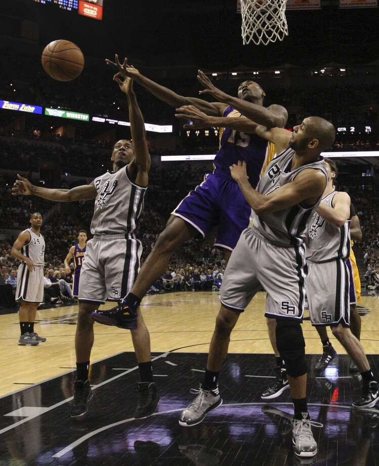 Los Angeles Lakers\' Metta World Peace gets pressure by San Antonio Spurs\' Kawhi Leonard, left, and Tim Duncan during the first half of game 1 in the first round of the NBA Playoffs at the AT&T Center, Sunday, April 21, 2013. The Spurs won 91-79.