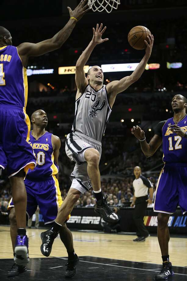 San Antonio Spurs\' Manu Ginobili drives to the basket during the second half of game 1 in the first round of the NBA Playoffs against the Los Angeles Lakers at the AT&T Center, Sunday, April 21, 2013. The Spurs won 91-79.