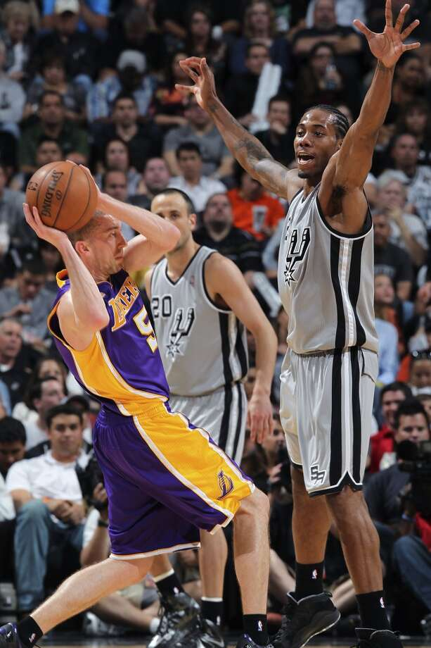 San Antonio Spurs\' Kawhi Leonard puts pressure on Los Angeles Lakers\' Steve Blake during the second half of game 1 in the first round of the NBA Playoffs at the AT&T Center, Sunday, April 21, 2013. The Spurs won 91-79.