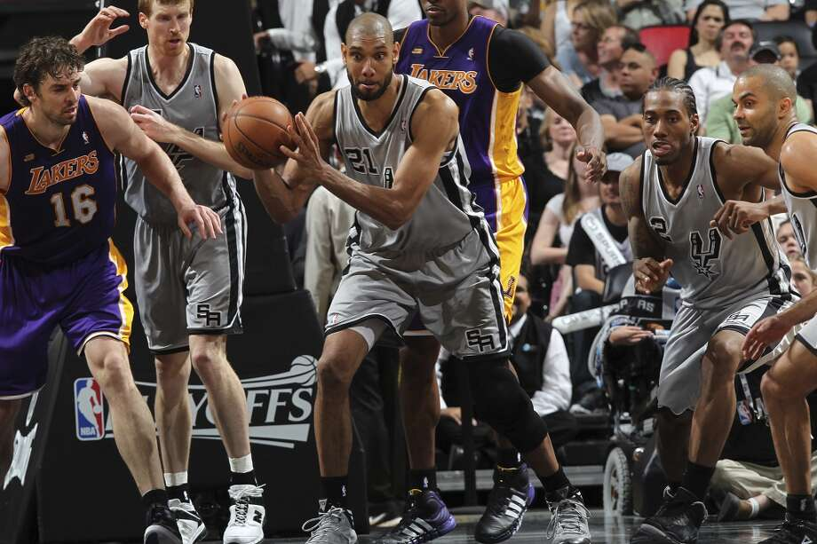 San Antonio Spurs\' Tim Duncan picks a loose ball against the Los Angeles Lakers during the second half of game 1 in the first round of the NBA Playoffs at the AT&T Center, Sunday, April 21, 2013. The Spurs won 91-79.