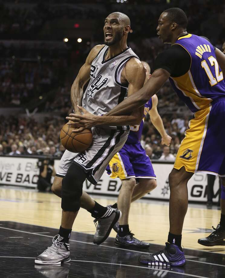 Los Angeles Lakers\' Dwight Howard strips the ball away from San Antonio Spurs\' Tim Duncan during the second half of game 1 in the first round of the NBA Playoffs at the AT&T Center, Sunday, April 21, 2013. The Spurs won 91-79.