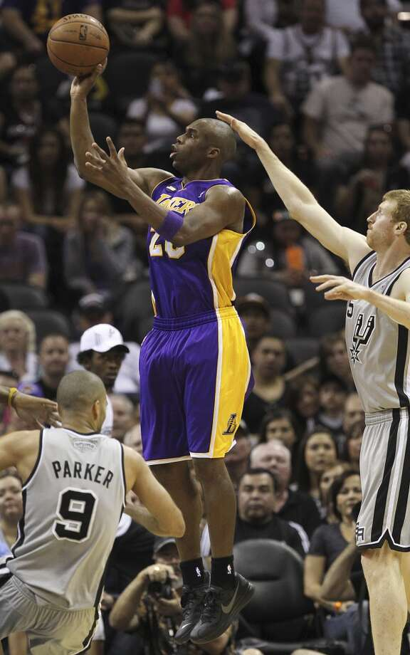 San Antonio Spurs\' Matt Bonner tries to defend against Los Angeles Lakers\' Jodie Meeks during the first half of game 1 in the first round of the NBA Playoffs at the AT&T Center, Sunday, April 21, 2013.