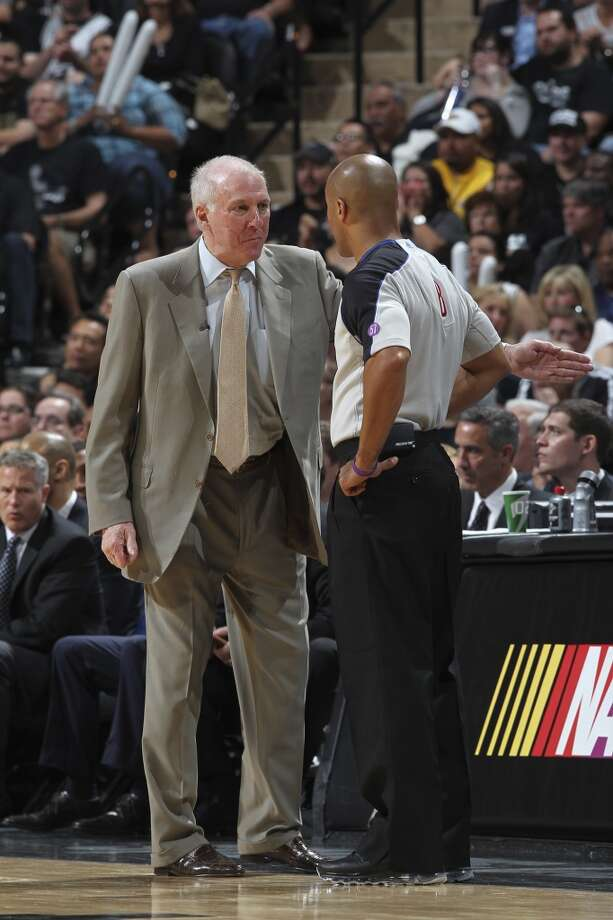 San Antonio Spurs head coach Gregg Popovich talks with official Marc Davis during the second half of game 1 in the first round of the NBA Playoffs against the Los Angeles Lakers at the AT&T Center, Sunday, April 21, 2013. The Spurs won 91-79.