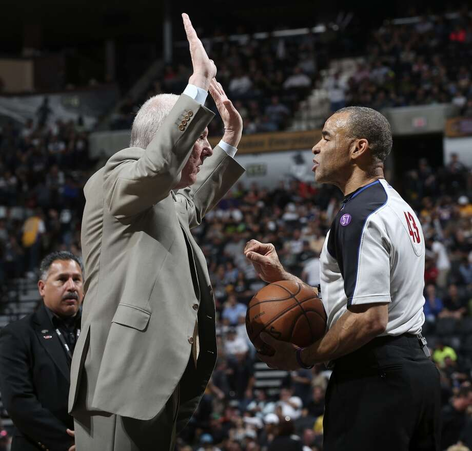 San Antonio Spurs head coach Gregg Popovich talks with official Danny Crawford during the first half of game 1 in the first round of the NBA Playoffs against the Los Angeles Lakers at the AT&T Center, Sunday, April 21, 2013.