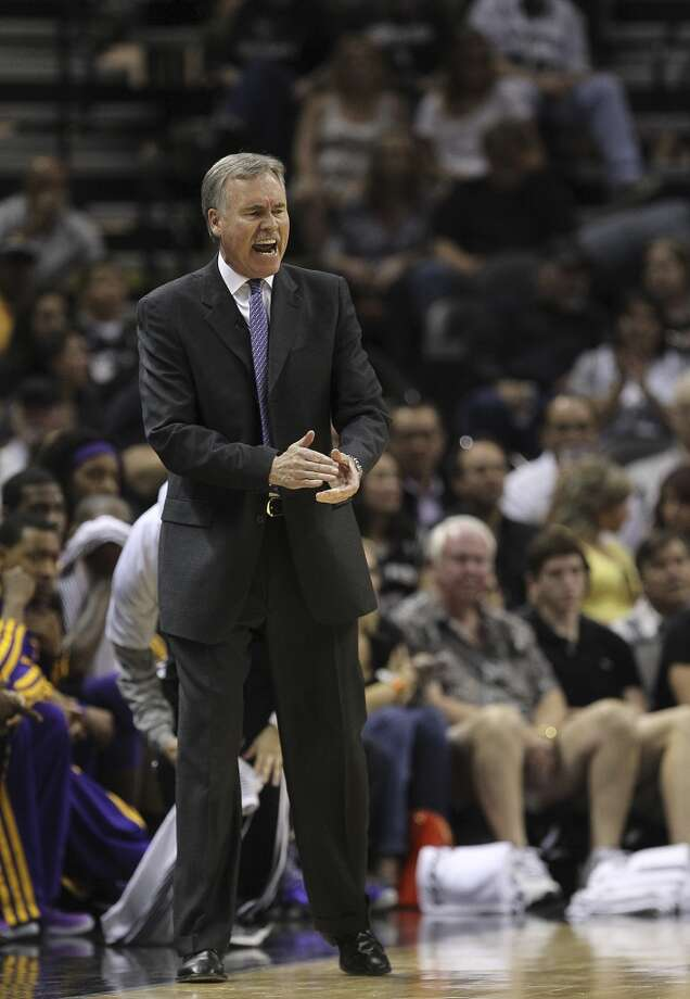 Los Angeles Lakers head coach Mike D\'Antoni encourages his team during the first half of game 1 in the first round of the NBA Playoffs against the San Antonio Spurs at the AT&T Center, Sunday, April 21, 2013.