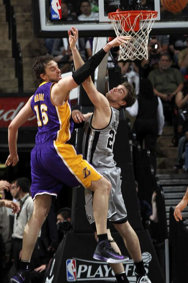 San Antonio Spurs\' Tiago Splitter puts pressure on Los Angeles Lakers\' Pau Gasol during the second half of game 1 in the first round of the NBA Playoffs at the AT&T Center, Sunday, April 21, 2013. The Spurs won 91-79.