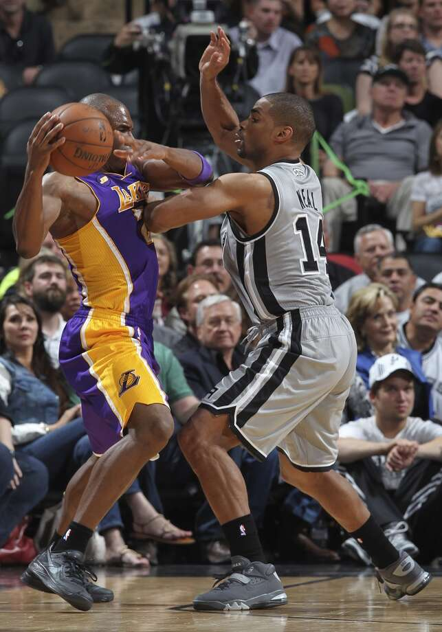 San Antonio Spurs\' Gary Neal puts pressure on Los Angeles Lakers\' Jodie Meeks during the second half of game 1 in the first round of the NBA Playoffs at the AT&T Center, Sunday, April 21, 2013. The Spurs won 91-79.