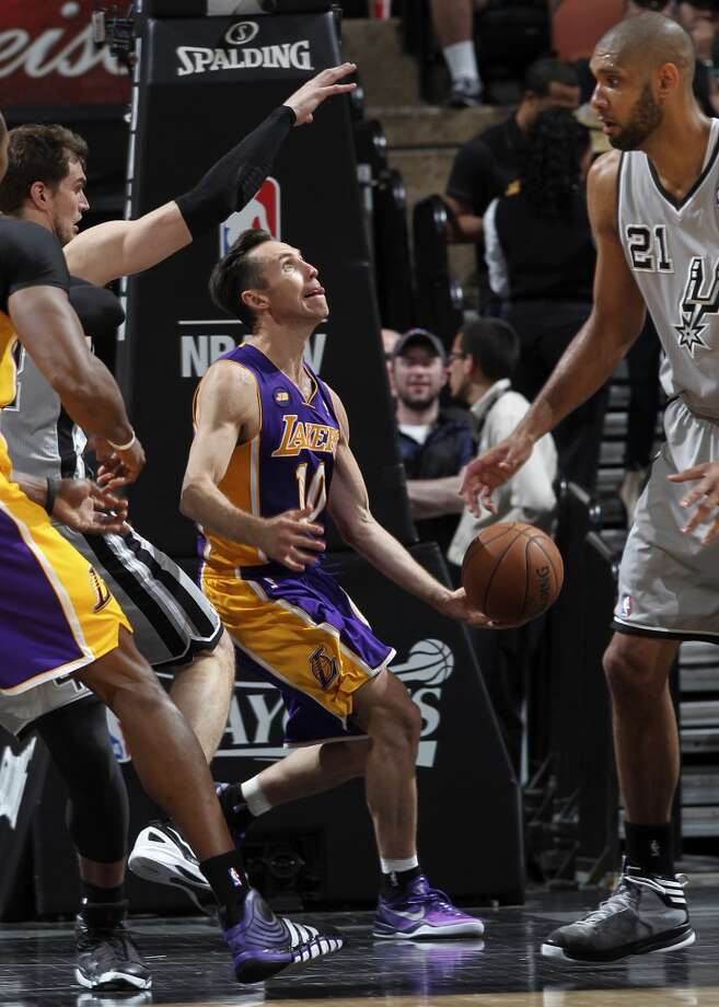 Los Angeles Lakers\' Steve Nash tries to shoot under the basket during the second half of game 1 in the first round of the NBA Playoffs against the San Antonio Spurs at the AT&T Center, Sunday, April 21, 2013. The Spurs won 91-79.
