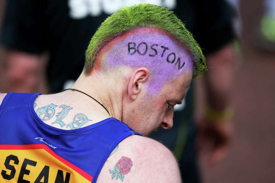 A competitor shows his sympathy towards the victims of the Boston Marathon bombing during the Virgin London Marathon 2013 on Sunday in London. A defiant, festive mood prevailed in London as thousands of runners offered tributes to those killed and injured in Boston. Photo: Chris Jackson, Staff / 2013 Getty Images