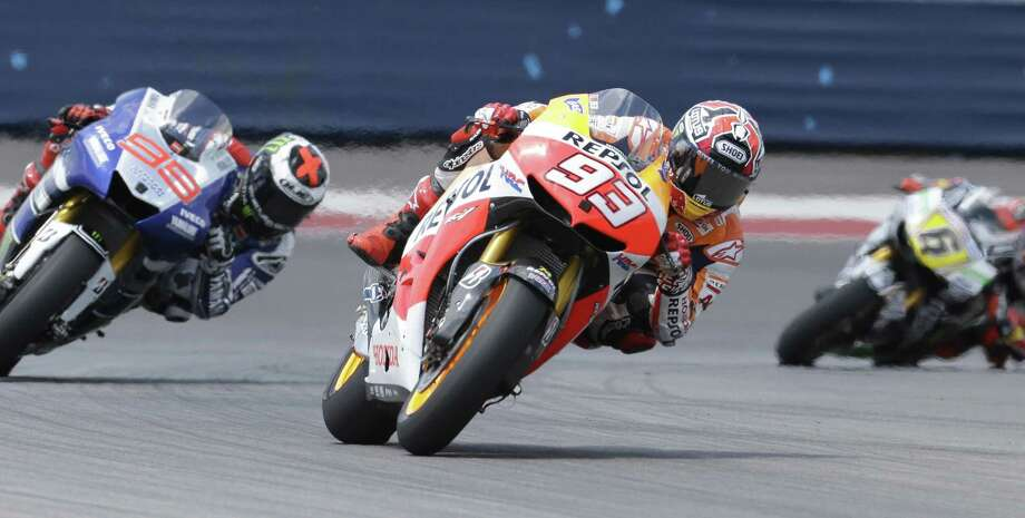 Marc Marquez of Spain leads coming out of a turn during the Red Bull MotoGP of the Americas on Sunday. The 20-year-old went on to win the race by 1.534 seconds ahead of Dani Pedrosa. Photo: LM Otero / Associated Press