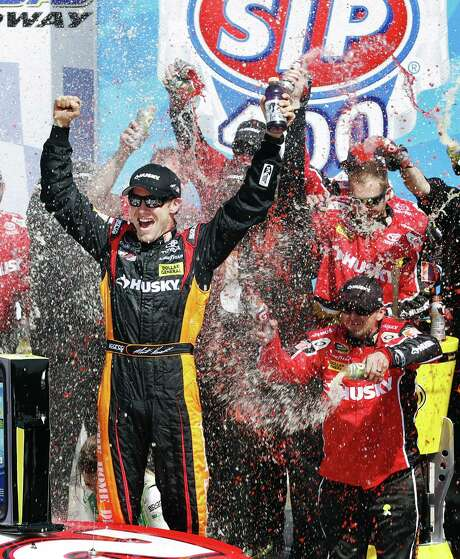 Matt Kenseth celebrates in Victory Lane after outracing Kasey Kahne at the end to win Sunday's race at Kansas Speedway. Photo: Orlin Wagner / Associated Press