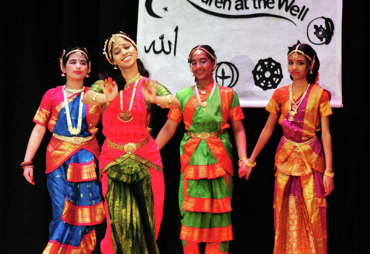 Traditional Indian dancers from the Narthanalaya School of Dance performed Sunday, April 21, 2013, during a multi-faith storytelling presentation from Children at the Well at Hudson Valley Community College in Troy, N.Y. Children at the Well promotes peace by bringing diverse teens together through the art of storytelling. (Will Waldron/Times Union)