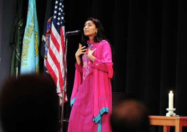 Sarah Syed, 18, of Niskayuna High School shares a story Sunday, April 21, 2013, during a multi-faith storytelling presentation from Children at the Well at Hudson Valley Community College in Troy, N.Y. Children at the Well promotes peace by bringing diverse teens together through the art of storytelling. (Will Waldron/Times Union) Photo: Will Waldron