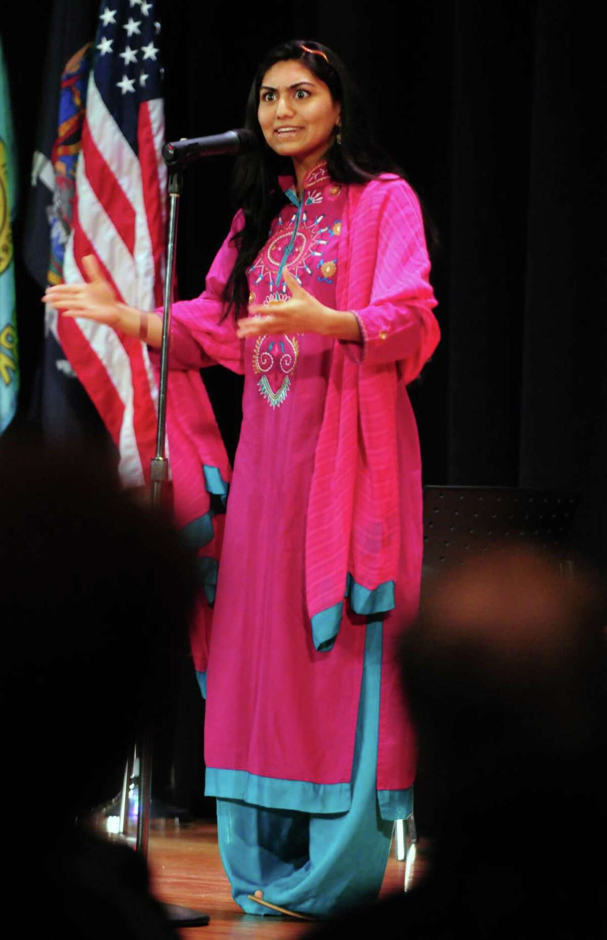 Sarah Syed, 18, of Niskayuna High School shares a story Sunday, April 21, 2013, during a multi-faith storytelling presentation from Children at the Well at Hudson Valley Community College in Troy, N.Y. Children at the Well promotes peace by bringing diverse teens together through the art of storytelling. (Will Waldron/Times Union)