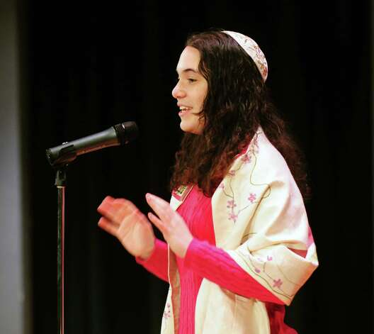 Macaela Rourke, 17, of Niskayuna High School shares a story Sunday, April 21, 2013, during a multi-faith storytelling presentation from Children at the Well at Hudson Valley Community College in Troy, N.Y. Children at the Well promotes peace by bringing diverse teens together through the art of storytelling. (Will Waldron/Times Union) Photo: Will Waldron