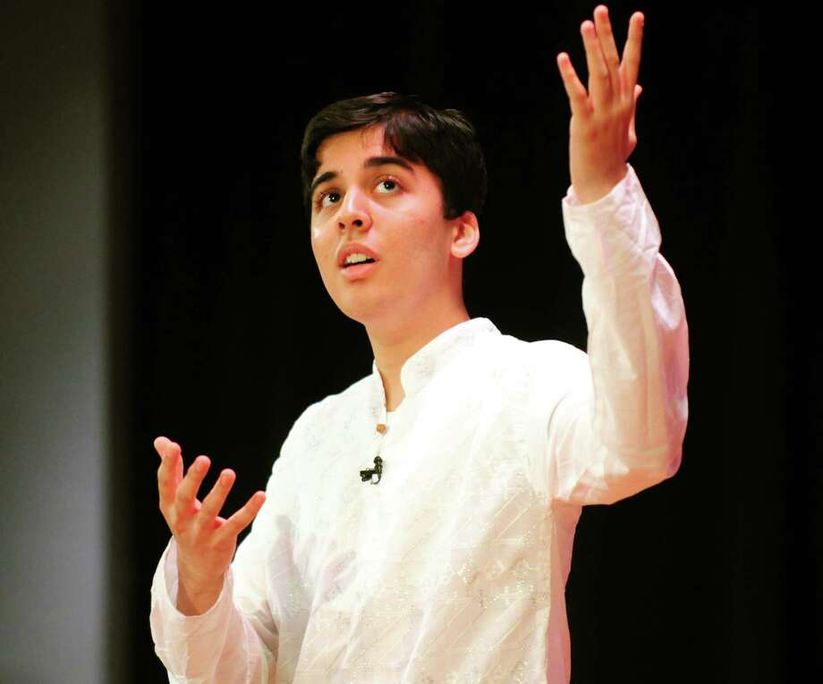 Aditya Agashe, 17, of Shaker High School shares a story Sunday, April 21, 2013, during a multi-faith storytelling presentation from Children at the Well at Hudson Valley Community College in Troy, N.Y. Children at the Well promotes peace by bringing diverse teens together through the art of storytelling. (Will Waldron/Times Union) Photo: Will Waldron