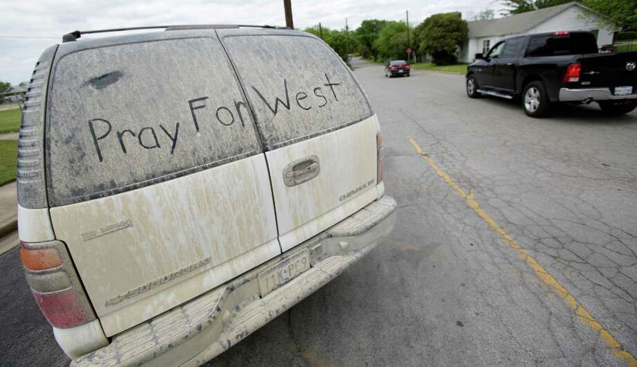A mesage written on the dust covered window of a vehicle parked in front of the West Elementary School on Sunday, April 21, 2013. Photo: Bob Owen, San Antonio Express-News / ©2013 San Antonio Express-News