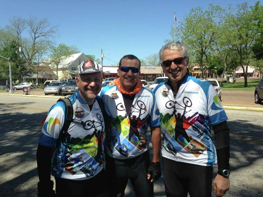Peter Dodd, center, accompanied by CGGVeritas teammates Keith Grodhaus, left, and Joe Lafico, completed the BP MS150 just 17 months after receiving a new heart.