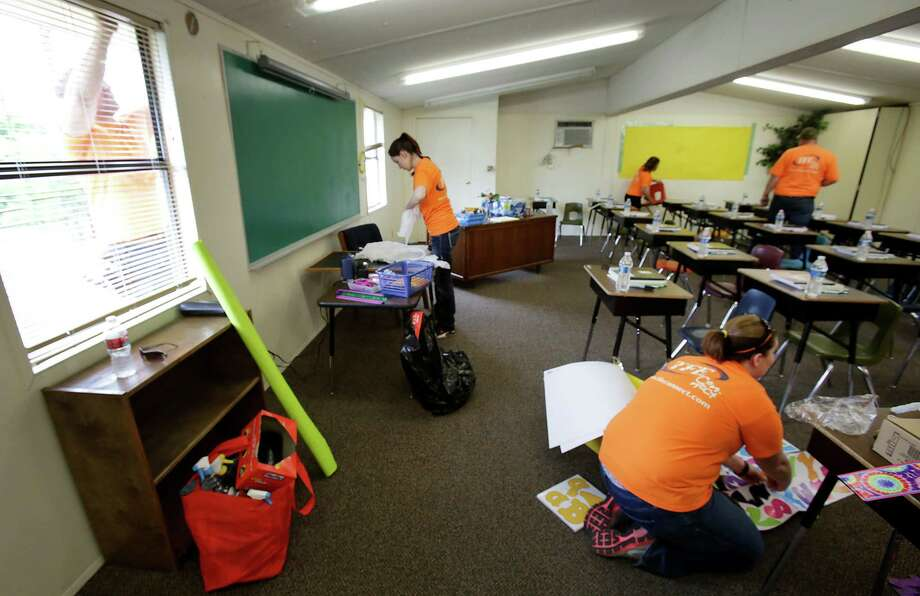 Workers from Technology for Education out of Hewitt, TX, prepare a portable classroom which was one of three donated by Grand Prairie ISD to West ISD, on Sunday April 21, 2013. Photo: Bob Owen, Express-News / ©2013 San Antonio Express-News