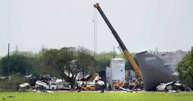Crane operators remove large sheets of metal at the site of the explosion in West, TX on Sunday April 21, 2013. Photo: Bob Owen, Express-News / ©2013 San Antonio Express-News