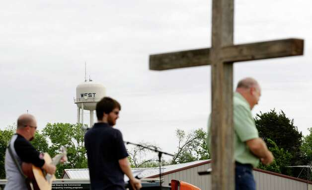 Pastor John Crowder, right, of First Baptist Church in West, holds service in a field because the church building is too damaged to worship in, on Sunday April 21, 2013. Crowder's house was totally distroyed by the explosion. Photo: Bob Owen, Express-News / ©2013 San Antonio Express-News