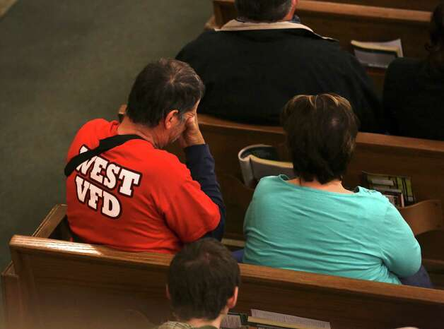 An unidentified injured member of the West VFD is over come with emotion during mass at the Church of the Assumption in West, TX on Sunday April 21, 2013. Photo: Bob Owen, Express-News / ©2013 San Antonio Express-News