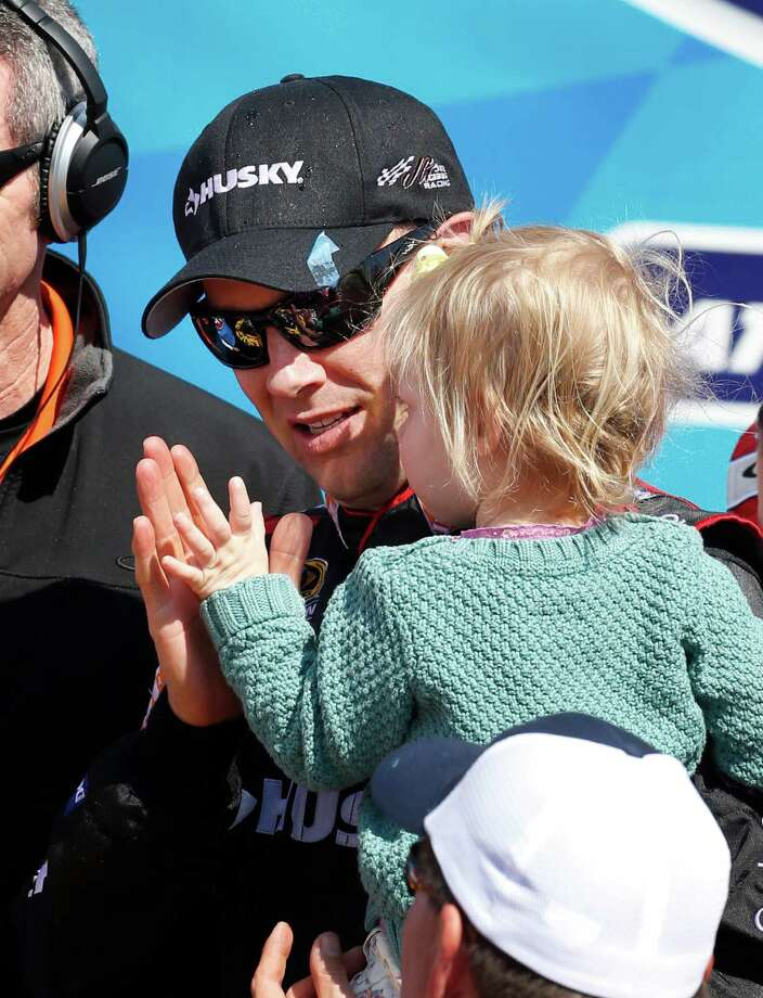 Two-year-old Grace Kenseth gives her father, Matt, a high-five for his Sprint Cup victory Sunday. Photo: Orlin Wagner, STF / AP