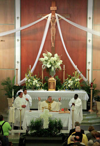 Bishop Joe S. Vasquez (center) leads a mass, Sunday April 21, 2013, at the Church of the Assumption after an explosion at a fertilizer plant that occurred Wednesday evening in West, Tx. Photo: Edward A. Ornelas, Express-News / © 2013 San Antonio Express-News
