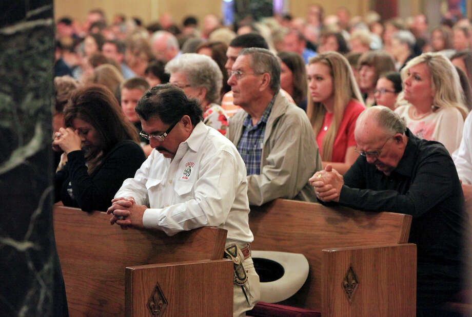 People pray during a mass at the Church of the Assumption ,Sunday April 21, 2013, after an explosion at a fertilizer plant that occurred Wednesday evening in West, Tx. Photo: Edward A. Ornelas, Express-News / © 2013 San Antonio Express-News